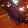 Two young women survive car flipped onto expressway